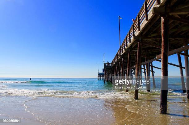 scenic view of sea against clear blue sky - newport beach stock pictures, royalty-free photos & images