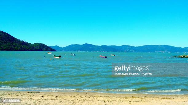 scenic view of sea against clear blue sky - praia stock pictures, royalty-free photos & images