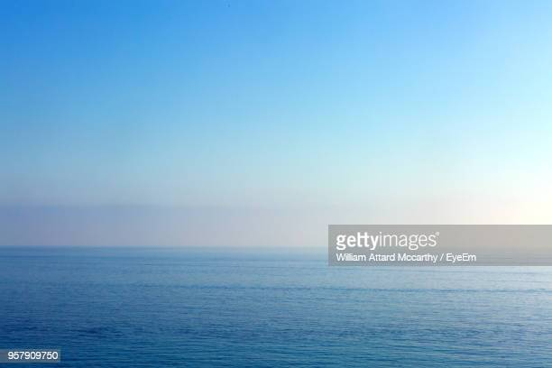 scenic view of sea against clear blue sky - horizon over water stock pictures, royalty-free photos & images