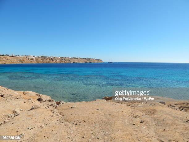 scenic view of sea against clear blue sky - oleg prokopenko stock pictures, royalty-free photos & images