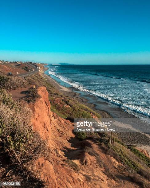 scenic view of sea against clear blue sky - carlsbad california stock pictures, royalty-free photos & images