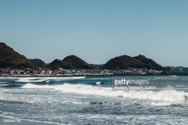 scenic view of sea against clear sky and port town in japan - koukichi stock pictures, royalty-free photos & images