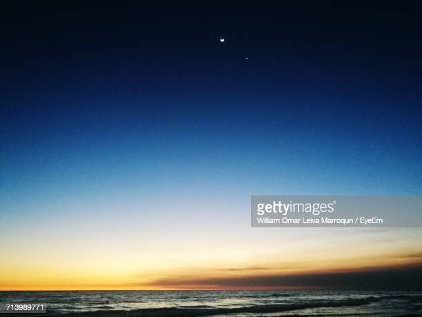 scenic view of sea against clear sky at night - william moon stock pictures, royalty-free photos & images
