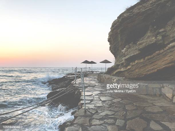 scenic view of sea against clear sky at sunset - nikitina stock pictures, royalty-free photos & images