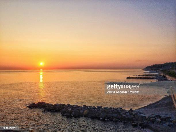 scenic view of sea against clear sky at sunset - sochi stock pictures, royalty-free photos & images