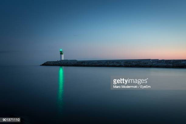 scenic view of sea against clear sky at sunset - lighthouse stock pictures, royalty-free photos & images