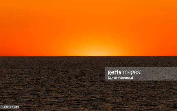 Scenic View Of Sea Against Clear Sky During Sunse