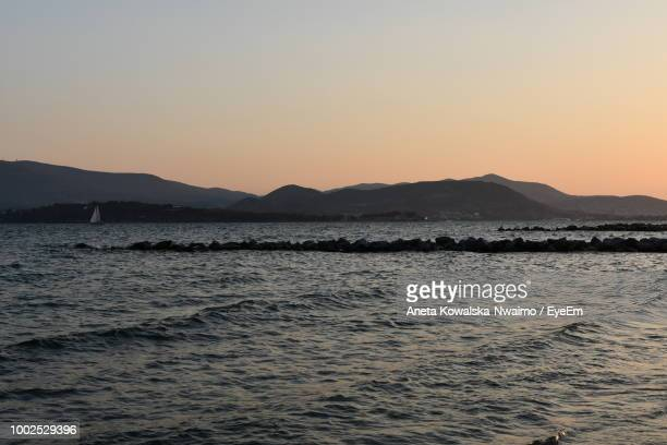 scenic view of sea against clear sky during sunset - aneta eyeem stock pictures, royalty-free photos & images