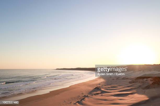 scenic view of sea against clear sky during sunset - port elizabeth südafrika stock-fotos und bilder