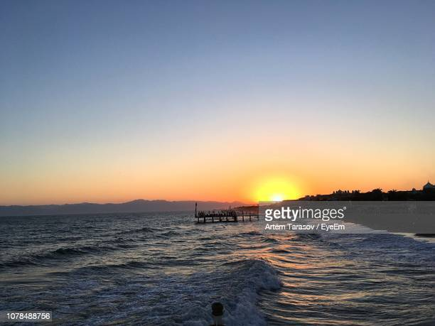 scenic view of sea against clear sky during sunset - belek stock pictures, royalty-free photos & images