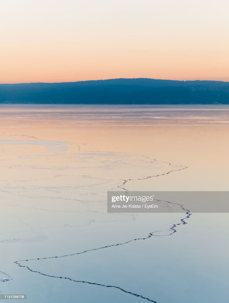 Scenic View Of Sea Against Clear Sky During Sunset : Stock Photo