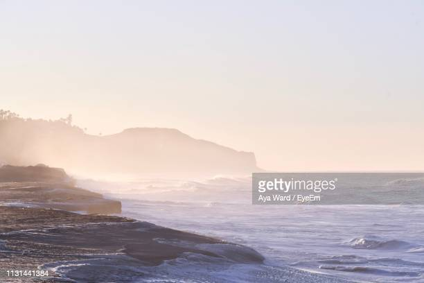 scenic view of sea against clear sky during sunset - malibu beach stock pictures, royalty-free photos & images