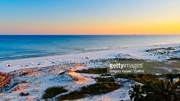 scenic view of sea against clear sky during sunset - gulf shores alabama stock pictures, royalty-free photos & images