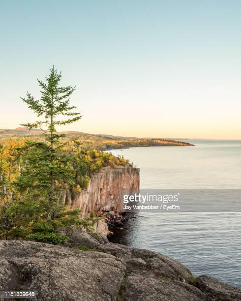 scenic view of sea against clear sky during sunset - minnesota stock pictures, royalty-free photos & images