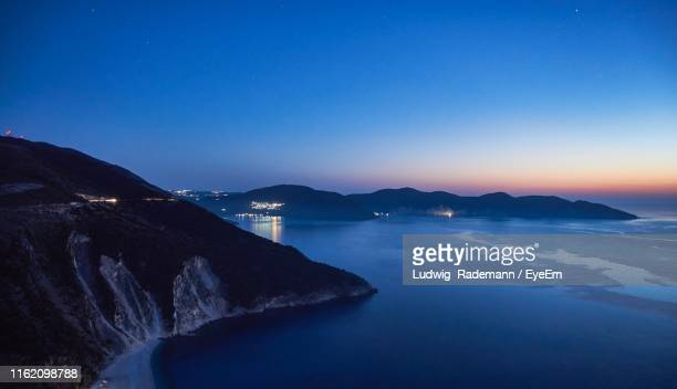 scenic view of sea against clear sky during sunset - rademann stock pictures, royalty-free photos & images