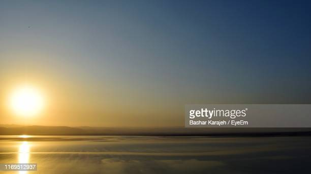 scenic view of sea against clear sky during sunset - ワイドショット ストックフォトと画像