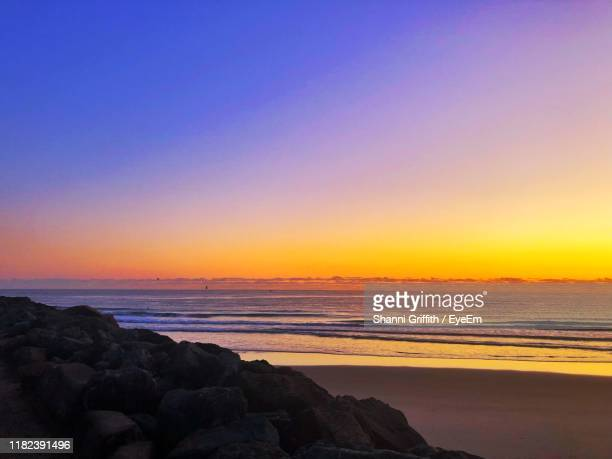 scenic view of sea against clear sky during sunset - clear sky stock pictures, royalty-free photos & images