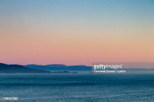 scenic view of sea against clear sky during sunset - campbell downie stock pictures, royalty-free photos & images