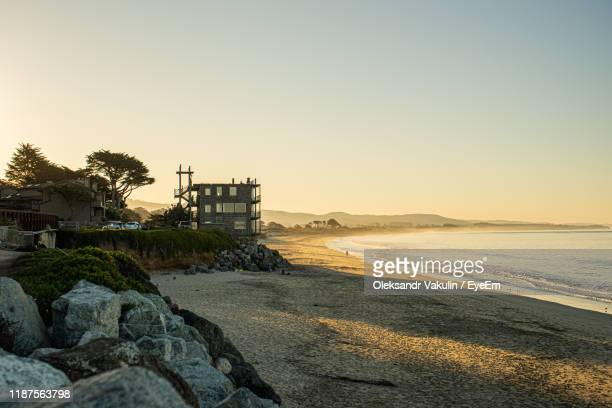 scenic view of sea against clear sky during sunset - oleksandr vakulin stock pictures, royalty-free photos & images