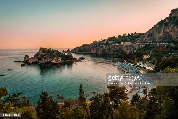 scenic view of sea against clear sky during sunset - taormina stock pictures, royalty-free photos & images