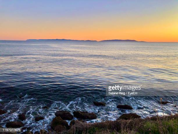 scenic view of sea against clear sky during sunset - rancho palos verdes stock pictures, royalty-free photos & images
