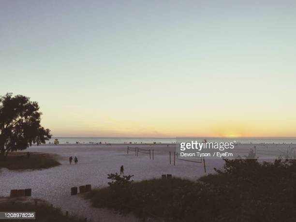 scenic view of sea against clear sky during sunset - siesta key stock pictures, royalty-free photos & images