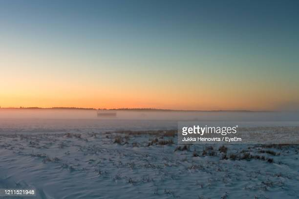 scenic view of sea against clear sky during sunset - heinovirta stock pictures, royalty-free photos & images