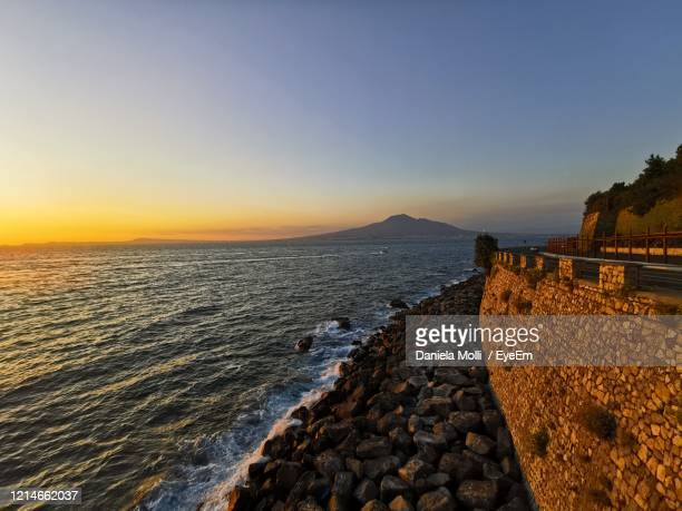 scenic view of sea against clear sky during sunset - 防波堤 ストックフォトと画像