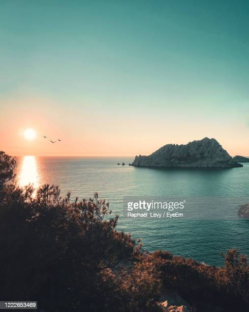 scenic view of sea against clear sky during sunset - bouches du rhone stock pictures, royalty-free photos & images