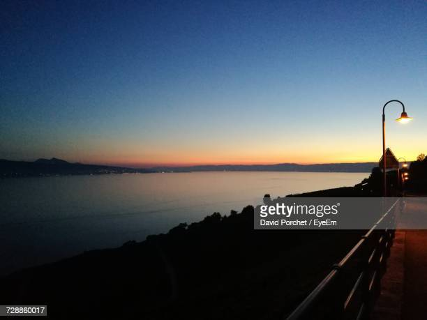 scenic view of sea against clear sky during sunset - david porchet photos et images de collection