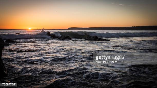 scenic view of sea against clear sky during sunset - mevagissey stock photos and pictures