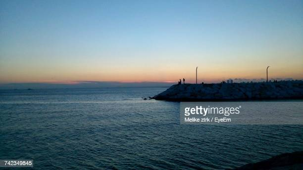 scenic view of sea against clear sky during sunset - melike stock pictures, royalty-free photos & images