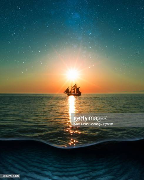 scenic view of sea against clear sky during sunset - pirate ship stock photos and pictures
