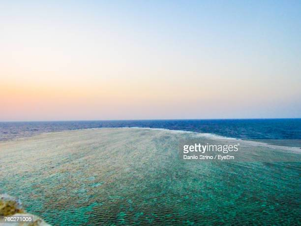 scenic view of sea against clear sky during sunset - red sea stock pictures, royalty-free photos & images