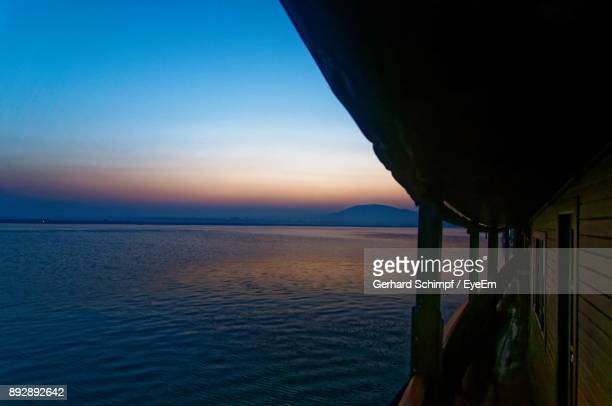 scenic view of sea against clear sky during sunset - gerhard schimpf stock photos and pictures
