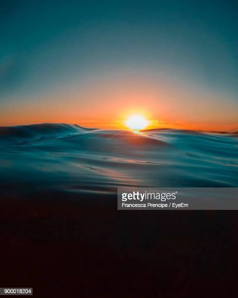 scenic view of sea against clear sky during sunset - sunset in the ocean stock pictures, royalty-free photos & images