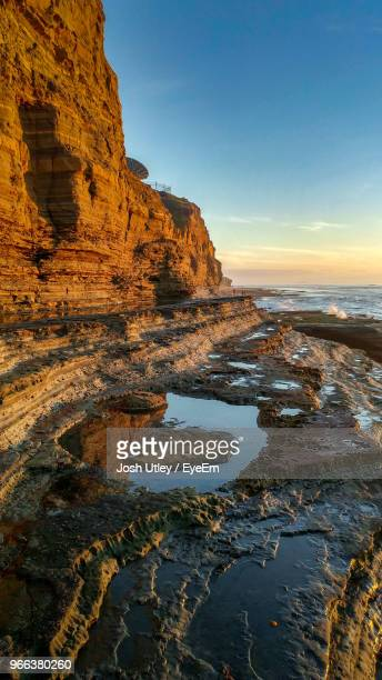 scenic view of sea against clear sky during sunset - josh utley stock pictures, royalty-free photos & images