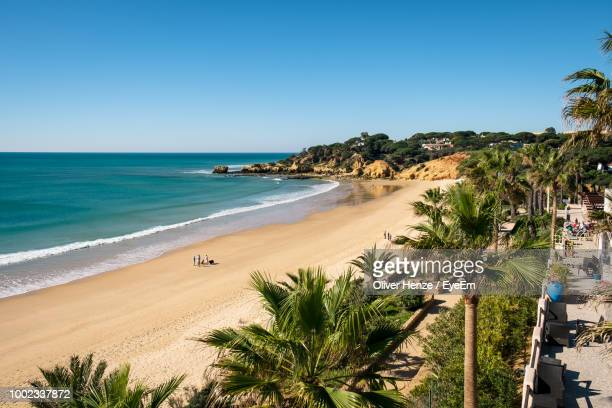 scenic view of sea against clear sky - albufeira stock photos and pictures