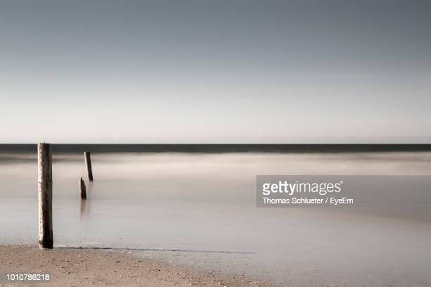 scenic view of sea against clear sky - husum stock-fotos und bilder