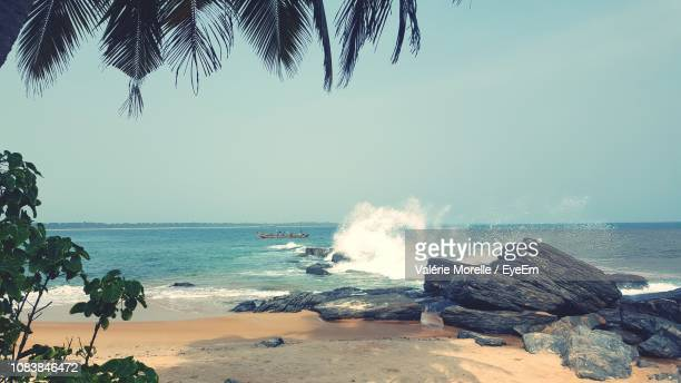scenic view of sea against clear sky - côte d'ivoire stock pictures, royalty-free photos & images