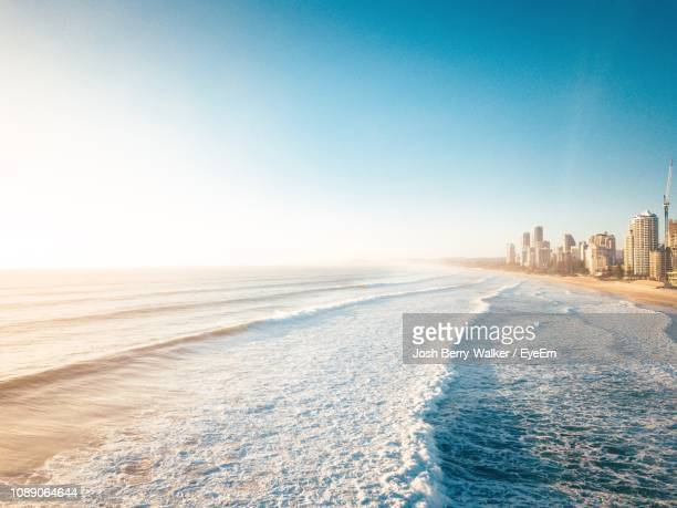 scenic view of sea against clear sky - gold coast queensland stock pictures, royalty-free photos & images