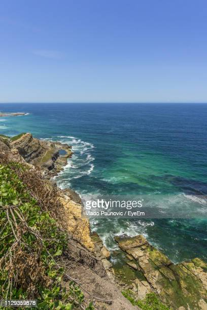 scenic view of sea against clear sky - 豪州 ニューカッスル ストックフォトと画像