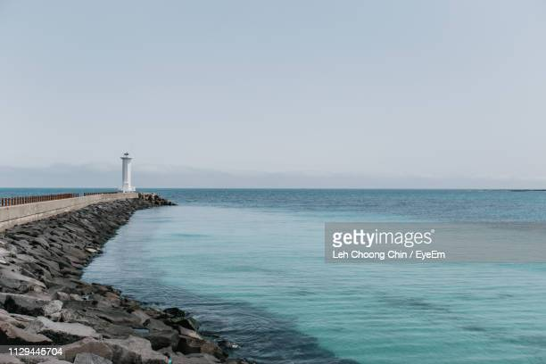 scenic view of sea against clear sky - jeju stock photos and pictures