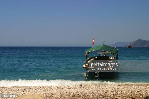 scenic view of sea against clear sky - jens helmstedt stock-fotos und bilder