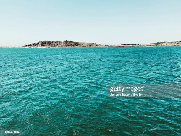 scenic view of sea against clear sky - coffs harbour stock pictures, royalty-free photos & images