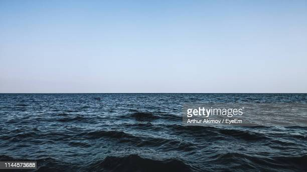 scenic view of sea against clear sky - atlantik stock-fotos und bilder