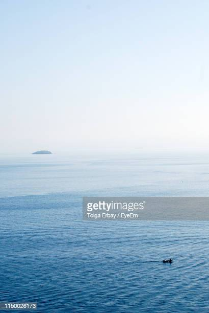 scenic view of sea against clear sky - tolga erbay stock photos and pictures