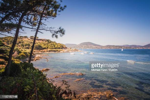 scenic view of sea against clear sky - st tropez stock pictures, royalty-free photos & images