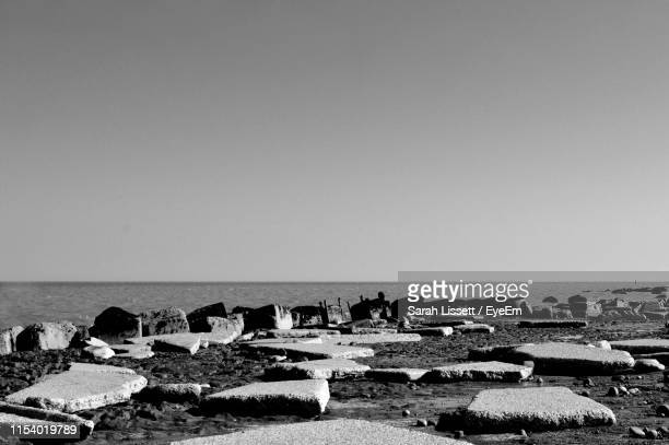 scenic view of sea against clear sky - sarah sands stock pictures, royalty-free photos & images