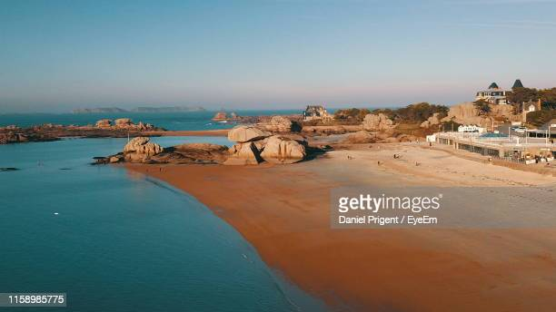 scenic view of sea against clear sky - cotes d'armor stock photos and pictures